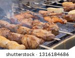 kebab and fish are cooked on... | Shutterstock . vector #1316184686