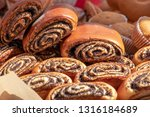 buns with poppy seeds close up. ... | Shutterstock . vector #1316184689