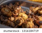 cooked champignons  roasted on... | Shutterstock . vector #1316184719