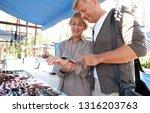 senior tourist couple visiting... | Shutterstock . vector #1316203763