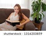 beautiful smiling young woman... | Shutterstock . vector #1316203859