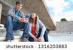 teenagers in skateboarding... | Shutterstock . vector #1316203883