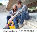 teenagers in skateboarding... | Shutterstock . vector #1316203886
