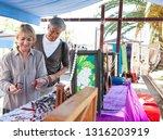senior tourist couple visiting...   Shutterstock . vector #1316203919