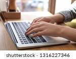 young woman working on laptop... | Shutterstock . vector #1316227346