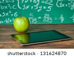 Digital tablet and apple on the ...