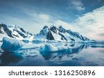 Blue Ice Covered Mountains In...