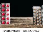 tablets on a wooden table... | Shutterstock . vector #1316273969