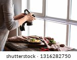 Stock photo young woman taking picture of food in professional studio 1316282750