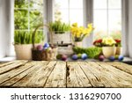 desk of free space and easter... | Shutterstock . vector #1316290700
