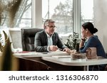 business issues. grey haired... | Shutterstock . vector #1316306870