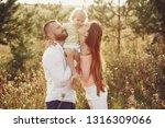 cute family in a field.... | Shutterstock . vector #1316309066