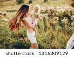 Cute family in a field. Beautyful mother with her little daughter.