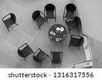 table with chairs from above.... | Shutterstock . vector #1316317556