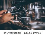 barista making coffee with... | Shutterstock . vector #1316319983