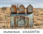 rusty mail boxes in rural new... | Shutterstock . vector #1316320733