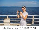 cruise ship woman using mobile... | Shutterstock . vector #1316323163