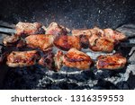 pieces of grilled pork with red ... | Shutterstock . vector #1316359553