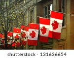 a row of canadian flags outside ... | Shutterstock . vector #131636654