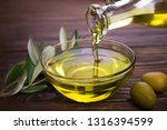 bowl with olive oil on wooden... | Shutterstock . vector #1316394599