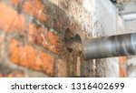 drilling a brick wall with a... | Shutterstock . vector #1316402699