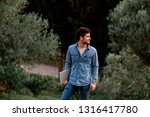 man in jeans suit standing with ...   Shutterstock . vector #1316417780