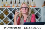 a woman with a glass of wine... | Shutterstock . vector #1316425739