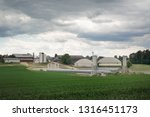 dark clouds over a farm with... | Shutterstock . vector #1316451173