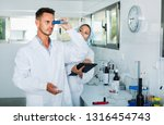 two young  positive researchers ... | Shutterstock . vector #1316454743