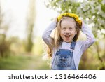 spring sunny portrait of a cute ...   Shutterstock . vector #1316464406