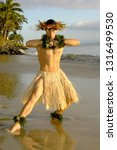 this male hula dancer poses in... | Shutterstock . vector #1316499530