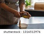housekeeper peel potatoes with...   Shutterstock . vector #1316512976