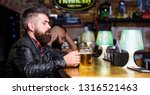 hipster relaxing at pub. guy... | Shutterstock . vector #1316521463