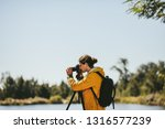 side view of a photographer...   Shutterstock . vector #1316577239