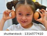portrait of a little girl... | Shutterstock . vector #1316577410