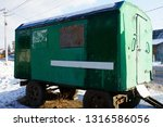 one green old metal trailer...   Shutterstock . vector #1316586056