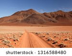 sand track in the namib rand... | Shutterstock . vector #1316588480