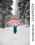 happy girl in snowy forest... | Shutterstock . vector #1316593229
