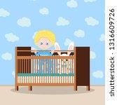 happy baby boy in blue... | Shutterstock .eps vector #1316609726