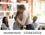 relieved man and woman hugging... | Shutterstock . vector #1316614316