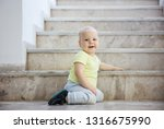 baby girl at bottom of stairs... | Shutterstock . vector #1316675990