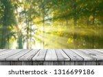 empty wooden table background | Shutterstock . vector #1316699186