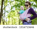 young woman carrying her baby... | Shutterstock . vector #1316713646