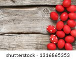 pile of red easter eggs on old... | Shutterstock . vector #1316865353