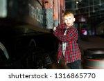 smiling boy standing next to...   Shutterstock . vector #1316865770