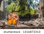 A Small Statue Of Ganesh The...
