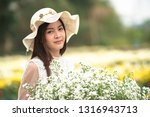 beautiful girl in the flowers... | Shutterstock . vector #1316943713