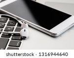 phone with white headphones on...   Shutterstock . vector #1316944640