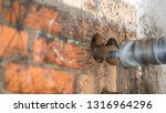 drilling a brick wall with a... | Shutterstock . vector #1316964296