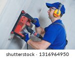 electrician at work. cutting... | Shutterstock . vector #1316964950